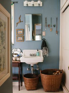 blue bathroom with woven baskets