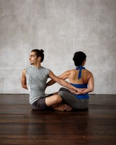 Infinity Twist  Benefits: Increases blood flow to the spinal disks, rejuvenating the back; enhances flexibility; relieves tension.  How to Do It: Sit cross-legged facing each other, knees overlapping. Inhale, lengthen the spine, and twist to the right, reaching your right arm behind you. With your right hand, grab your partner's left wrist or hand, and vice versa. Exhale and pull gently; hold the pose for 3 breaths. Release and reverse the twist.