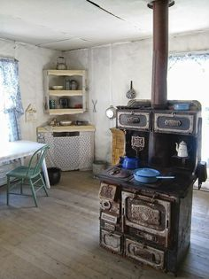 Cast Iron Cookstove placed centrally to transfer heat efficiently throughout the room.