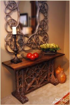 Oversized Celtic knot mirror and rustic wood console table.                                   Love the mirror!