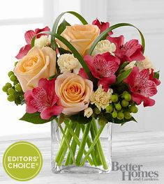The Better Homes and Gardens All Aglow Bouquet. Light up their life with incredible color and blooming beauty when you send this exquisite flower bouquet. Unforgettable peach roses are surrounded by red Peruvian lilies, pale yellow mini carnations, green hypericum berries, lily grass blades, and lush greens to create a stunning flower arrangement. Presented in a clear glass cube vase.