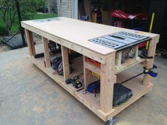 Woodworking Bench Workbench with built-in table saw and router locations. I would love for Robert to have this. - Building a nice workbench is important. Many have come up with their own approaches. Here's how to build one using basic tools. Garage Tools, Garage Shop, Garage Workshop, Workshop Ideas, Diy Garage, Workshop Design, Workshop Plans, Small Garage, Workshop Bench