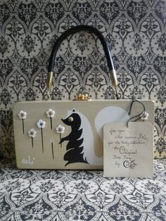 Enid Collins bags... I have one somewhere from when I was little...