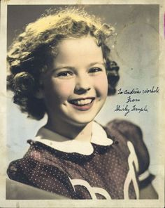 """Hand-colored studio portrait of Shirley Temple with handwritten inscription: """"To Andrew Worhola [sic] from Shirley Temple"""", 1941     hand-colored sepia print    10 x 8 in. (25.4 x 20.3 cm.)    The Andy Warhol Museum, Pittsburgh; Founding Collection, Contribution The Andy Warhol Foundation for the Visual Arts, Inc.    TC61.3"""
