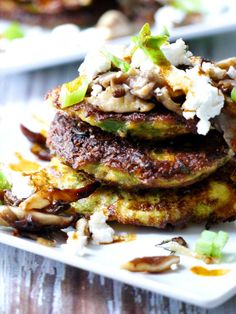 Zucchini Pancakes with Wild Mushrooms, Crumbled Goat Cheese & Garlic Chili Oil #glutenfree #recipe #delicious