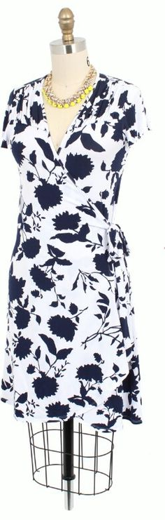 Dear Stylist- wrap dresses in classic colors with simple prints are great for work.