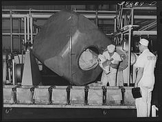 Taking butter out of churns at the Dairymen's Cooperative Creamery. The most modern churns in the USA 1941