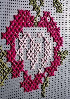 metal tools perforired panel + colored wool yarn
