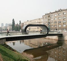 Unique pedestrian bridge with a large loop in the middle provides access to the Academy of Fine Arts in Sarajevo.
