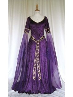 Fab sleeves!!  Purple and black, accented with gold, is always a great combination.  This gown looks like only Royalty should wear it!  Velvet Medieval Dress - DevilInspired.co.uk