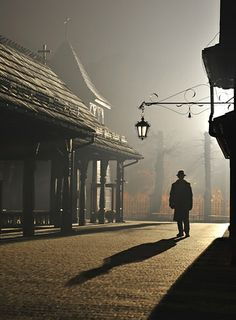 Silhouette of a man by the parish church: Kasia Nowak photograph
