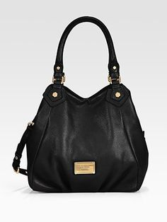 Can you truly ever go wrong with a class black leather bag? I think not!
