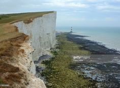 Lighthouse and chalk cliffs of Beachy Head near Eastbourne from the South Downs Way, East Sussex, England, UK