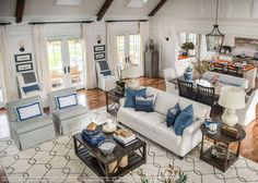 This dream home has a similar feel to yours. Just take a peek and see what grabs you ( and what doesn't) Notice the neat bench for the dining table and the mix of chairs too.
