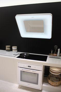 Miele's version is a luminous, modern hood that lights as well as vents your cooking space.