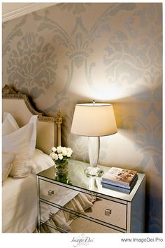 A glamalista would love this room! Headboard, side dresser, lighting, glass bead wall finish.