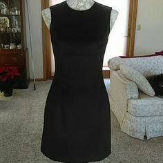 "Price Drop!!! Vintage BCBG  Little Black Dress Gorgeous little black dress.  Timeless and classic.  Sleeveless. This is an older dress kept in pristine condition.   It's marked as a size 4 which is more like a 2 now.  Waist is 30"" hips 34"" bust 34"". BCBG Dresses Mini"
