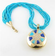 Tear Drop necklace by Ben Nighthorse. 18kt yellow gold with diamonds, turquoise, and lapis is to die for!