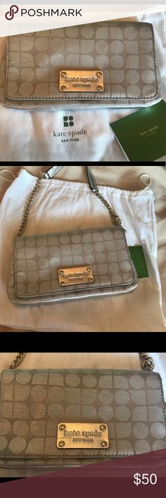 """Kate Spade Clutch Beautiful authentic small Kate Spade handbag. Can be carried as a clutch or use the leather and chain strap. Cute with jeans or as the perfect LBD accent for a night out! Gorgeous metallic silver/grey fabric with leather accents and silver hardware. Cute black and white polka dot fabric interior with card slots. Mint condition only used once. Includes Kate Spade dust bag and product information card. Approx 8.5""""L x 4.75""""H x 1.25""""W kate spade Bags"""