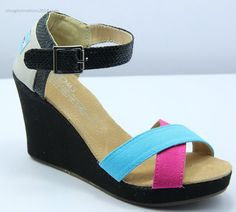 Blue Pink Canvas Womens Strappy Wedges Toms wedges continue to be a top seller with its comfort style fit that is perfect for everyday wear. And with the bright and beautiful colors available you can now match them to any outfit in your closet.