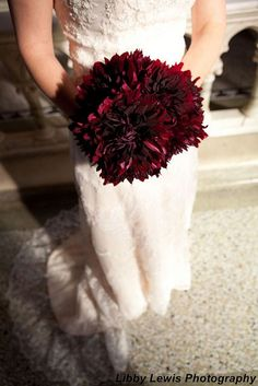 Deep burgundy dahlias. Rich colour! Would love having pops of color (calla lilies maybe?) in between, but yes.
