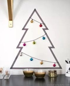 For something a little more chic, try the easy DIY Washi Tape Christmas Tree that has beco. Christmas Tree Wall Decal, Live Christmas Trees, Diy Felt Christmas Tree, Christmas Crafts, Christmas Decorations, Half Christmas, Christmas Island, Wall Decorations, Xmas Tree