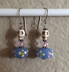 These sweet little skulls are perfect for Día de los Muertos! Floral Calavera Earrings (skull)   on Etsy, $15.00