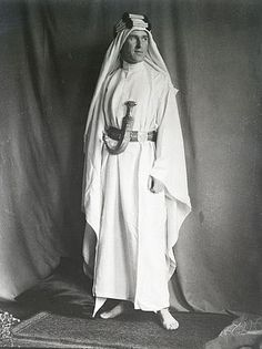 "TE Lawrence, 1919, in Hashemite finery given to him by Prince Feisal.  Feisal recommended that Lawrence wear Arab clothes so he'd ""fit in"". He obviously didn't wear this white silk and gold finery out in the field. Ordinary clothes were of cotton, linen and an outer robe of wool. He found the Arab clothes very practical and much more comfortable than European costume."
