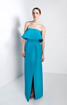 Silk faille. Straight strapless neckline Removable frill at top Seam at waistline Column skirt with slit at left side Concealed back zipper Fully lined Shell: 100% Silk Lining: 100%…