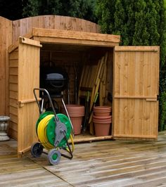 garden shed for trash and mower overlap mower store