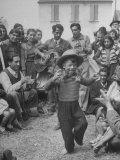 French Gypsies Playing Music and Watching Dancing Boy Impressão fotográfica premium por Yale Joel