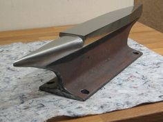 If you want to get started blacksmithing and can't find an anvil, you can make one out of a piece of RR track for small items and knives.