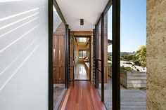 The bridge between the exisiting house and Kids Pod forms a straight line between corridors in the existing house and new | Kids Pod by Mihaly Slocombe (2014) | Merricks, Victoria, Australia | photo: Emma Cross
