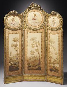 A LOUIS XVI STYLE GILTWOOD THREE-LEAVES SCREEN