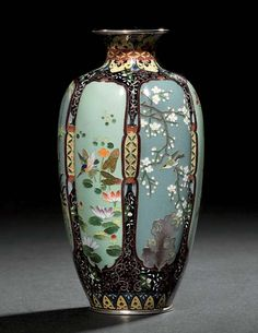 A CLOISONNÉ VASE  MEIJI PERIOD (LATE 19TH CENTURY)  Worked in copper and silver wire and coloured enamels with panels of birds including kingfishers, cockerels and swallows and various flowers and foliage, silver mounts 12cm. high