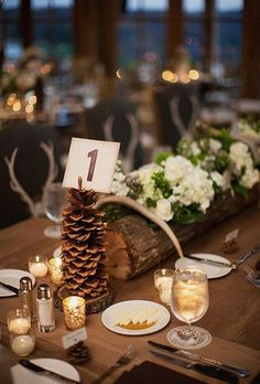 Put flowers in a log and stick table numbers into giant pinecones