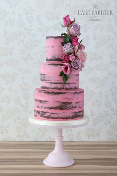 'A RUSTIC HOT PINK AFFAIR' Wedding Cake - 3 tiers of decadent chocolate cake coated in a thin layer of pink buttercream.