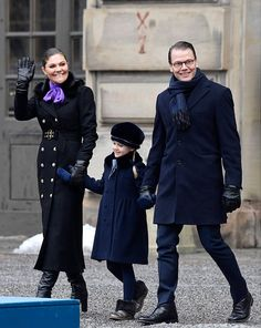 Sweden's Crown Princess Victoria opted for a stylish black military trench coat embellished with gold buttons. The elegant coat fell to her ankles, and was adorned with a faux fur collar. Teamed with a pair of leather gloves and knee high boots. Joined by her dapper husband Prince Daniel and their little Princess Estelle put on a stylish display in a navy coat and matching tights, ensuring she kept cozy in fur lined ankle boots, accessorize with a velvet blue hat and gloves for the occasion