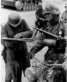 """panzerbekampfer: """"A platoon commander hands over a message to the division to a dispatch rider """""""