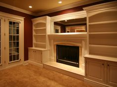 built-ins around tv in family room by Tianna Jacobs Tv Built In, Built Ins, Built In Around Fireplace, Basement House, Cozy Fireplace, Up House, Home Upgrades, New Home Designs, House Floor Plans