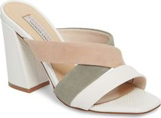 Kristin Cavallari Lola Slide Sandal in White. Mixed-finish straps crisscross atop a square-toe slide sandal lifted by a flared block heel. Mule Sandals, Slide Sandals, White Block Heels, Mode Shoes, Women's Shoes, Block Heel Shoes, Casual Heels, Fashion Sandals, Pretty Shoes