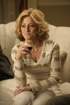 Carmela Soprano - always loved her personal style. Layered booshie gold chains, long clear/french tip acrylic nails, jumpsuits, big hair, tan skin. awesome!