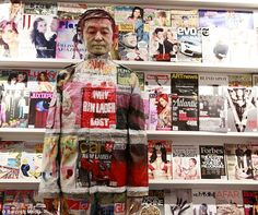 Disappearing act: Chinese artist Liu Bolin blends himself into a magazine rack