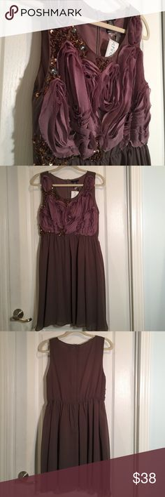 Esley dress NWT from American Threads When you want to dress up and feel beautiful yet have the freedom to dance and have fun THIS IS THE DRESS! Color is burnt purple. Esley Dresses Midi