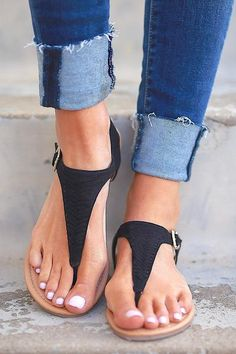 The perfect little sandal for all your spring & summer looks! Black, woven strap sandals with buckle closure at ankle. Man-made materials. *Fit is true to s