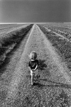She's walking alone thinking about what she wants to be when she grows up.  Even a child needs quiet from time to time.
