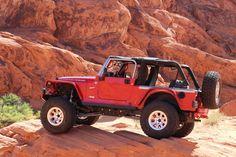 """Jeep Wrangler LJ W/ flat fenders, Raceline Wheels, 37"""" BFG MT, LVRC Bumper, Poison Spyder armor, Rock Hard Cage, LVRC high line hood, LVRC 44 front ARB lock."""