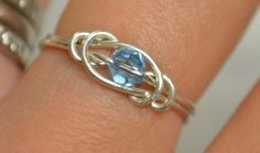 Aquamarine love knot ring sterling silver wire handmade with Swarovski crystal March birthstone Jewelry made to order.