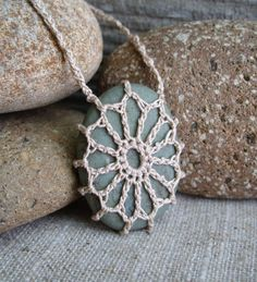 If you are looking for a unique one-of-kind gift for anyone, these Crocheted river rock necklaces should be perfect!      I crocheted this Montana river rock necklace with fine 100% cotton thread in an Ecru color. The stone is a beautiful sage green.      The length of the crocheted chain is -25  Stone size is 1 1/4 x 1