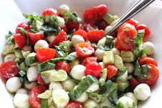 Mozzarella, Tomato and Avocado Salad  1 container cherry tomatoes, cut in half  1 carton fresh mozzarella cheese pearls, drained  1 avocado, peeled and diced  1/3 cup basil, julienned   2 tablespoons fresh parsley   1/4 cup lemon juice   1/4 cup olive oil    salt and pepper    baguette-optional